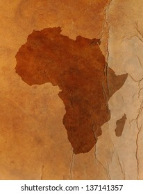 Water stain mark in the shape of the Africa continent map on a vintage brown leather parchment.