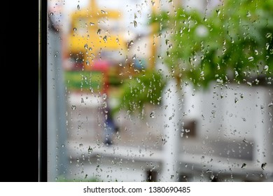 Water stains on the glass behind the rain.