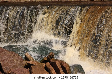water stream cascade falling on the rocks close up