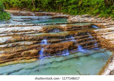 Water stream in mountain of Caucasus. The beautiful summer landscape with water and water stream on forest of Caucasus mountain.