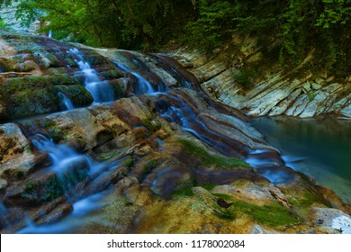 Water stream in mountain of Caucasus. The beautiful summer landscape in low key with water and water stream on forest of Caucasus mountain.