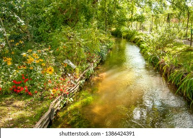 Water stream running through famous Claude Monet garden in Giverny, Normandy, France