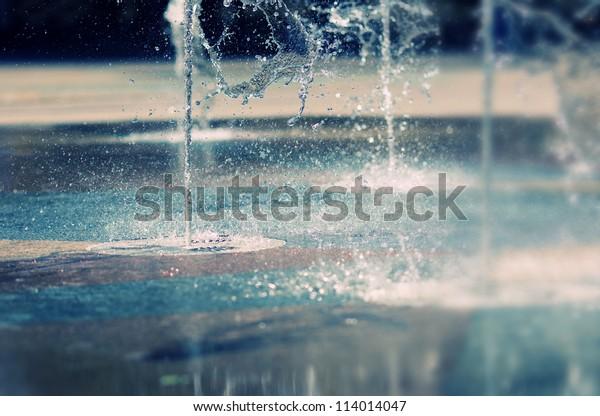 Water stream splashing on ground