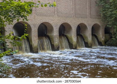 Water streaming through the Famous Sluice house or schuivenhuisje at Almelo Nordhorn Canal in Twente