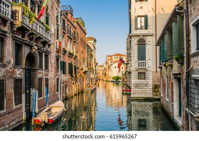 The water street of Venice in the rays of the setting sun of May