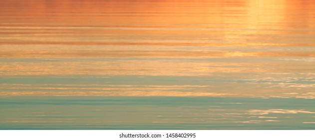 water surface background at sunset in summer