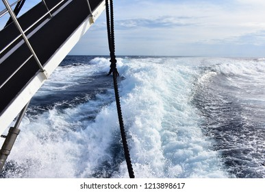 water surface behind of fast moving motor boat