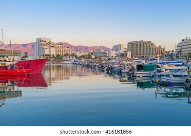 The water surface in marina and the mountains in the last sunset beams, Eilat, Israel.