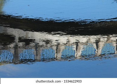 water surface with reflection of a bridge