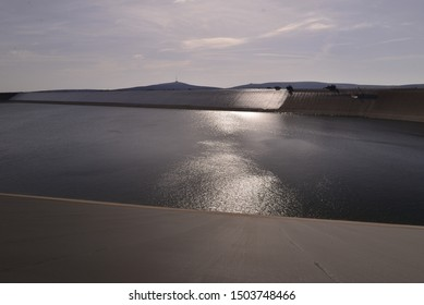 Water surface in strong opposite light with sunshine reflection.