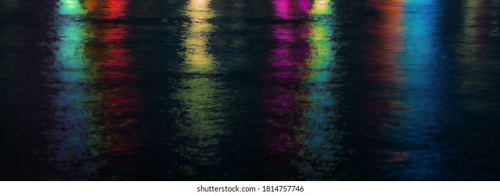 water surface with watercolor reflexions