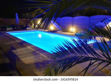 water of swimming pool illuminated in blue by night