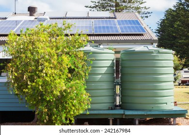 Water tank and solar panels on house