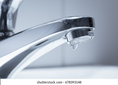 A water tap dripping