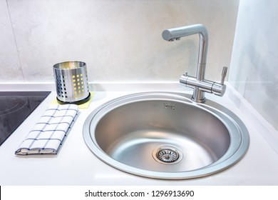 Water tap sink with faucet in expensive loft kitchen