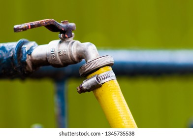 water tap and yellow hosepipe