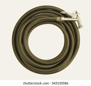 Water Taps And Brown Garden Hose With A Sprayer On A White Background