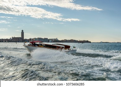 Water taxi commuting in the canals of Venice, motorboats are the common way of traveling