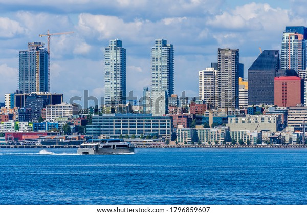 A water taxi cruises toware the skyline in Seattle, Washington.