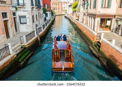 Water taxi on canal street in Venice, Italy.