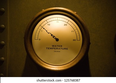 Water temperature gauge on rusty vintage steel