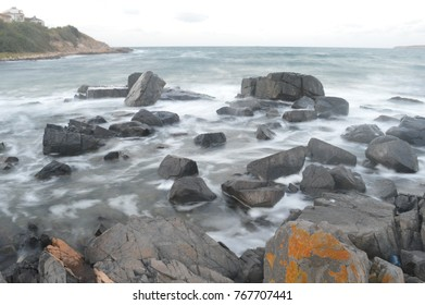 the water that crashes into the huge rocks of the sea