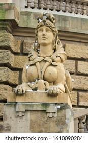 Water Tour called 'Wasserturm', landmark of German city Mannheim in small public park,statue on winter day