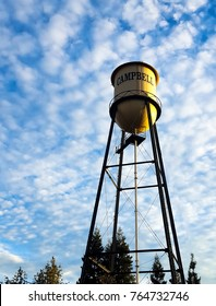 Water Tower against a blue sky with scattered clouds. City of Campbell, Northern California.