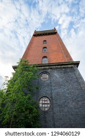 Water tower built from engineering bricks at a derelict lunatic asylum, Severalls, Colchester, Essex, England, UK