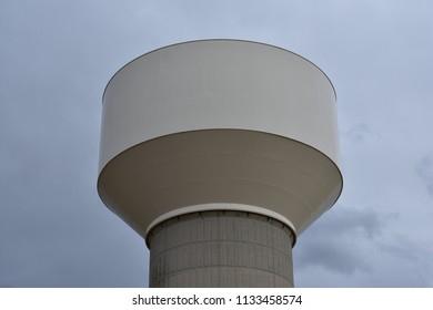 Water tower close up on a cloudy day