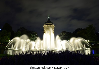 The water tower in Mannheim Germany at night. Long exposure gives the fountains a very smooth look.