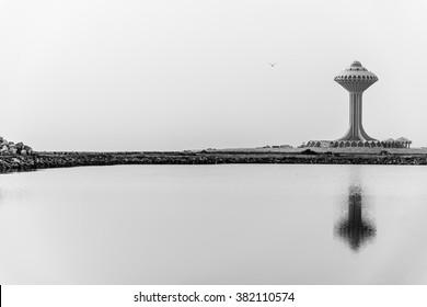 A water tower reflected in a pool of water on reclaimed land on the Arabian Gulf coast north of the Corniche in Al Khobar, Eastern Province, Saudi Arabia.