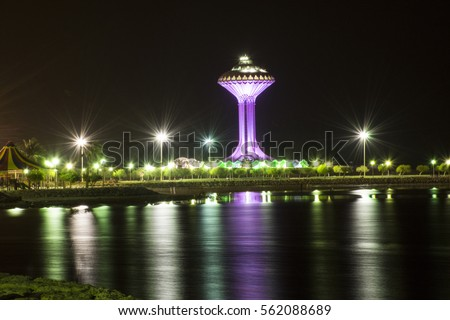 water-tower-reflection-on-night-450w-562