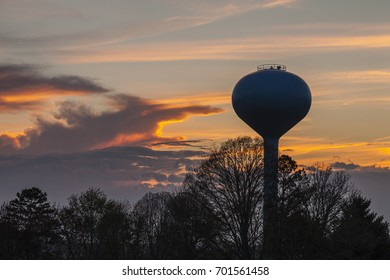 Water Tower Silhouetted in the Evening Sky
