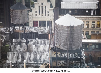 Water towers on rooftops skyline of New York City, southern view, filter effect