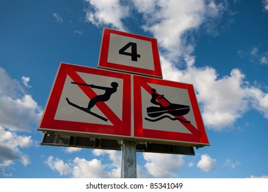 Water traffic signs against blue cloudy sky
