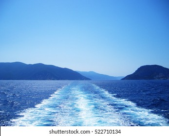 Water trail foaming behind a ferry boat in Aegean sea