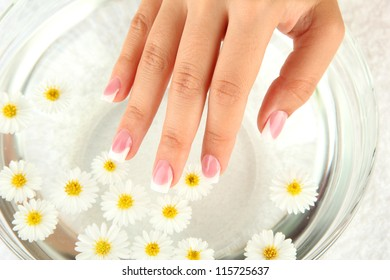 water treatment for female hands, close-up
