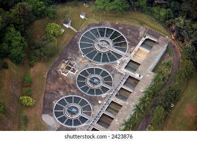 water treatment plant aerial view showing cicular shape clarifiers and square filters