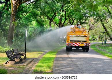 The water truck watering in the garden