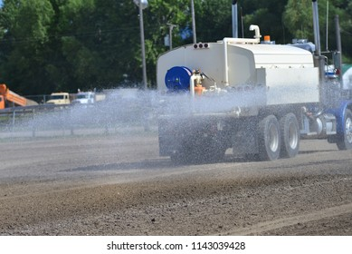 Water truck at work in rodeo arena