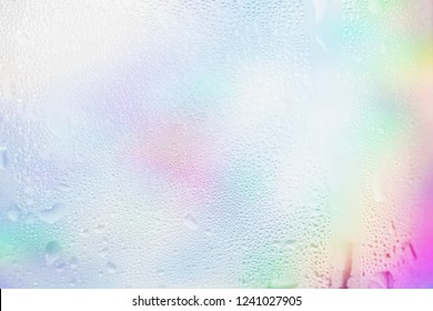 Water vapor in cold glass of Cold water , droplets Misted abstract pattern texture background. Rainbow colors