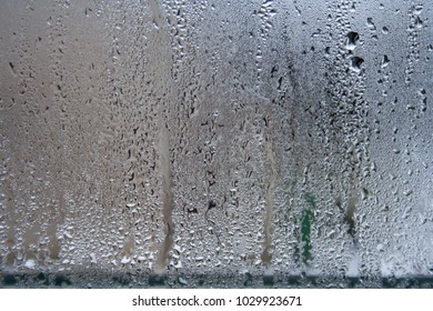 Water vapor and water drops on the glass. abstract background on window