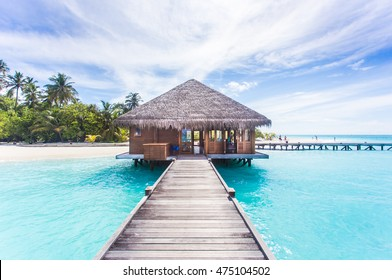 Water Villas (Bungalows) on the Perfect Tropical Island, Beautiful white sand on Tropical beach blue water blue sky with coconut palm , Maldives islands