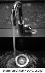 water wastage faucet running water in the kitchen in silver not frugal for a green environment protection
