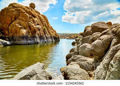 Water in Watson Lake, Prescott, Arizona, surrounded by large granite boulders