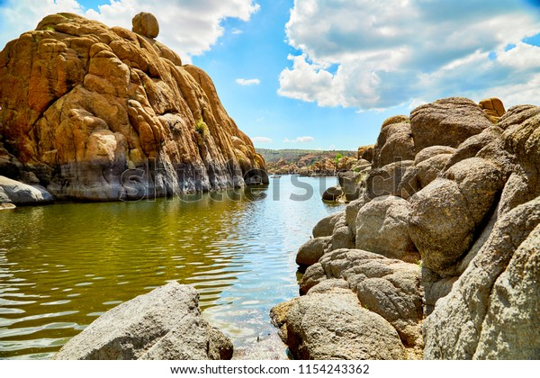 Water in Watson Lake, Prescott, Arizona, surrounded by large granite boulders