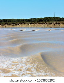 Water waves caused by the boat on the Guadalquivir River in Sanlúcar de Barrameda, Cádiz, Spain, guided visit by National Park of Doñana,