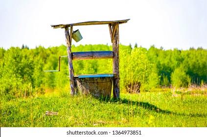 Water well in summer village scene. Village water well view. Water well scene. Rural water well