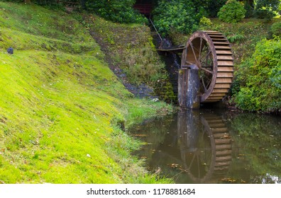 The water wheel and mill race at Beech Hill Hotel Londonderry with it's mill pond on an early afternoon in September.